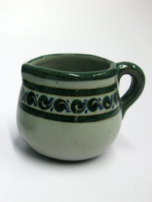 MEXICAN STONEWARE / 'Green Rim Paisley' Creamer / Ideal for a midday coffee or tea with friends, this creamer is adorned with a green and blue paisley pattern, bordered with a green rim.