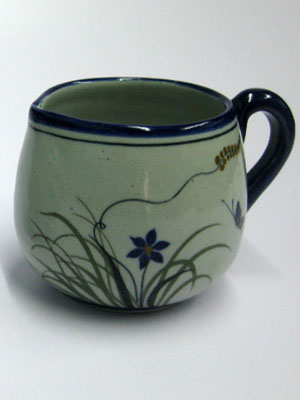 MEXICAN STONEWARE / 'Blue Rim Butterfly' Creamer / Ideal for a midday coffee or tea with friends, this creamer is adorned with a butterfly, flowers and grass bordered with a cobalt blue rim.