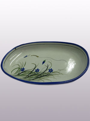Butterfly Dinnerware / 'Blue Rim Butterfly' Oval Serving platter / With a handcrafted design, this serving platter is perfect for fruit display on a table or serving the main dish. It is adorned with a butterfly, flowers and grass bordered with a cobalt blue rim.