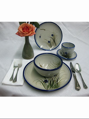 MEXICAN STONEWARE / 'Blue Rim Butterfly' 5 piece dinnerware set (1 person) / This ceramic dinnerware set has a handpainted decoration, it comes adorned with a butterfly, flowers and grass bordered with a cobalt blue rim. It includes one dinner plate, one salad plate, one soup bowl, a coffee cup and saucer.