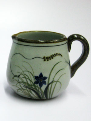 MEXICAN STONEWARE / 'Brown Rim Butterfly' Creamer / Ideal for a midday coffee or tea with friends, this creamer is adorned with a butterfly, flowers and grass bordered with a brown rim.