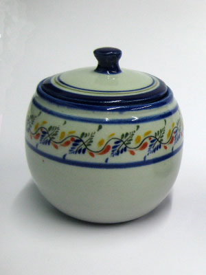MEXICAN STONEWARE / 'Tropical' Sugar bowl / This lovely sugar bowl comes adorned with a cobalt blue rim and a multicolor motif resembling tropical flowers.