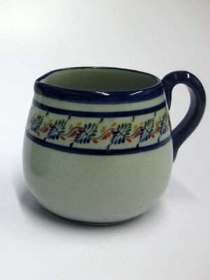 MEXICAN STONEWARE / 'Tropical' Creamer / Ideal for a midday coffee or tea with friends, this creamer is adorned with a multicolor motif resembling tropical flowers.