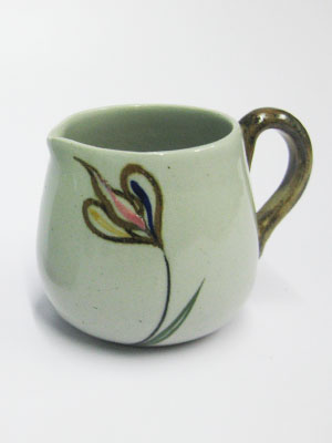 MEXICAN STONEWARE / 'Tulip' Creamer / Ideal for a midday coffee or tea with friends, this creamer is adorned with a multicolor tulip.