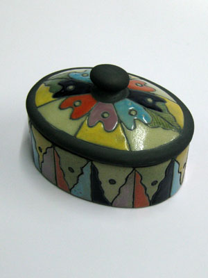 MEXICAN RAKU CERAMICS / Large oval jewelry box / This beautiful oval jewel box is perfect for keeping necklaces and earrings, or as a decorative item for your living room. It features a hand painted flower with different color petals on the lid.