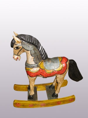 New Items / Carved horse rocking style 15 inch tall handpainted / This colorful rocking horse will stand out in your house or your office as a beautiful piece of art. It was hand carved and hand painted by skilled artisans in the state of Guanajuato in Mexico.