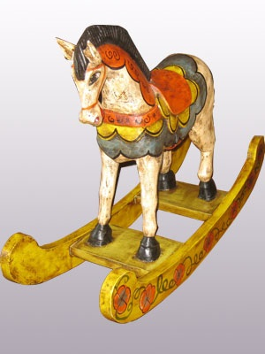 New Items / Carved horse rocking style 24 inch tall handpainted / This colorful rocking horse will stand out in your house or your office as a beautiful piece of art. It was hand carved and hand painted by skilled artisans in the state of Guanajuato in Mexico.