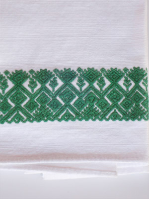 New Items / Green handwoven hand towel / This hand towel features traditional mayan weaving designs. It was hand woven and brocaded with a backstrap loom by a weaver from the Chiapas Highlands.