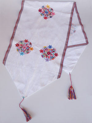 New Items / Handwoven table runner - Multicolor Flowers / Let the spring come into your home with this gorgeous table runner with a multicolor flowers design. It was hand woven using a backstrap loom, a system created during the Classic Maya period.