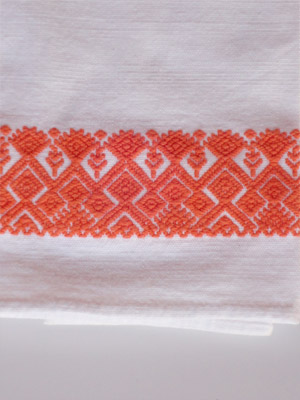 New Items / Orange handwoven hand towel / This hand towel features traditional mayan weaving designs. It was hand woven and brocaded with a backstrap loom by a weaver from the Chiapas Highlands.